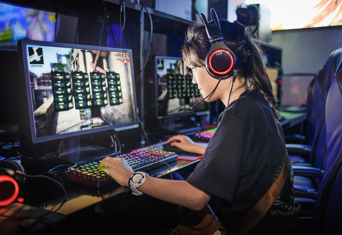 Girl playing online video game