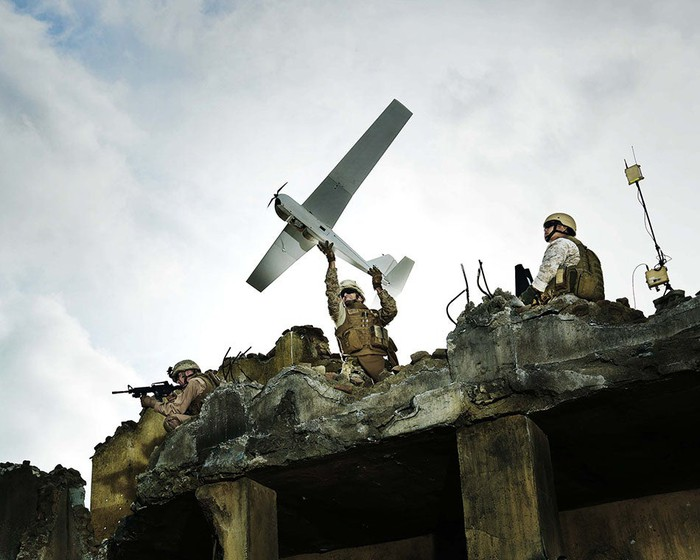 An AeroVironment drone in action, launched by military personnel.