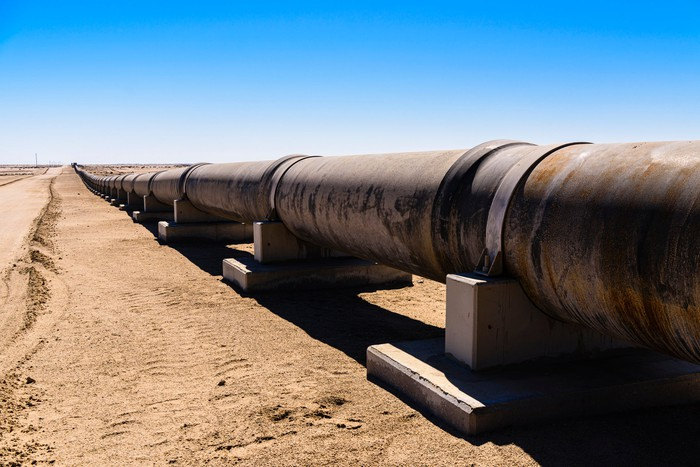 Large steel pipe in a desert landscape.