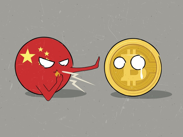 A cartoon figure of China blows a whistle and holds out a hand to stop a bewildered cartoon Bitcoin.