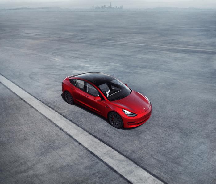 red Tesla model 3.