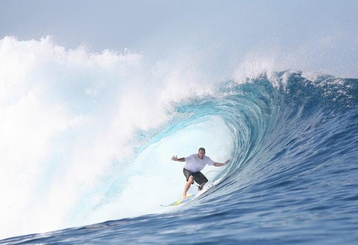 Surfer in a wave barrel.