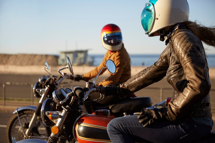 Two motorcyclists on light adventure motorcycles.