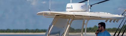 Garmin marine radar on top of recreational boat.