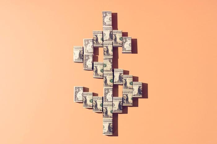 Cash arranged in dollar symbol.
