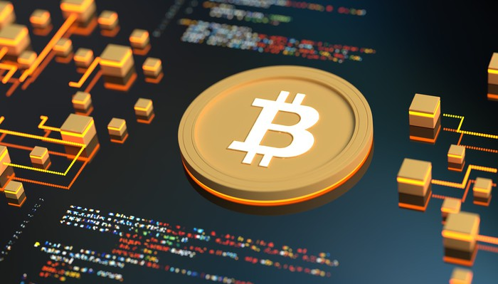 Bitcoin logo on graphic screen.