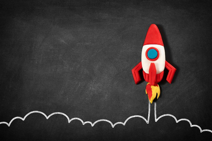 A launching space shuttle drawn on a blackboard.