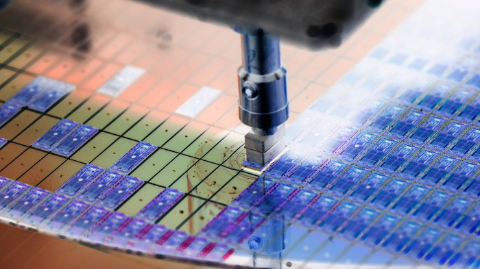 A machine engraves wafers on a printed circuit.