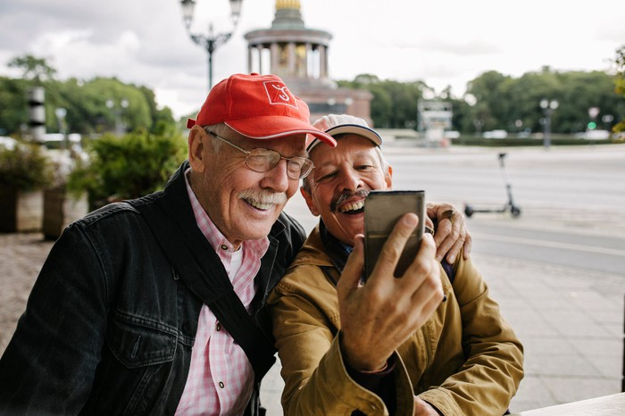 Two older people take a selfie.