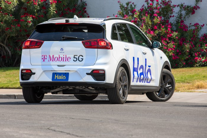 A halo self driving electric car viewed from the back.