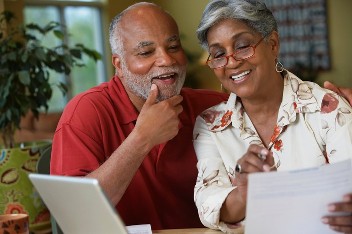A couple reviewing a statement.