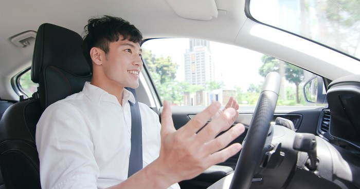 Happy driver with hands off the wheel