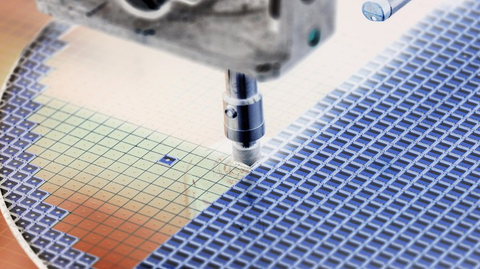 A machine deposits material onto a semiconductor wafer.