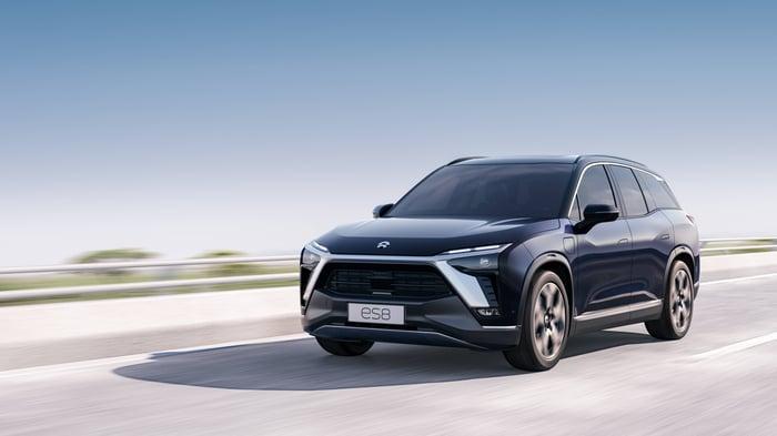 A dark blue NIO ES8, a large electric luxury SUV.