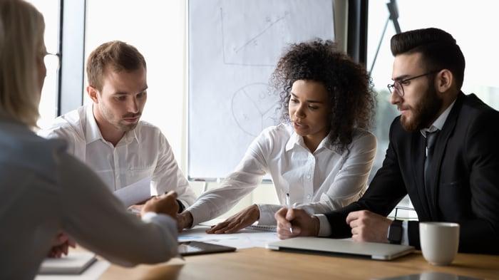 Executives study their company's finances.