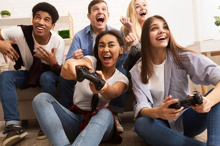 Friends playing video games.