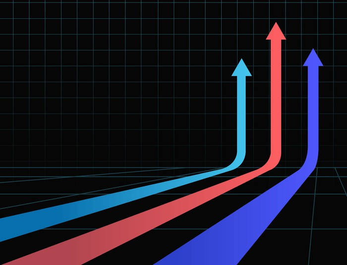 Three colorful arrows racing straight up on a black background.