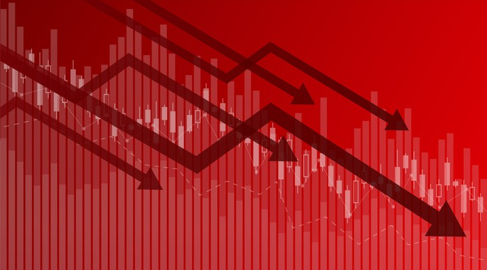 Arrows pointing down on red chart background.