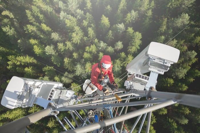 Worker climbing a cell tower.