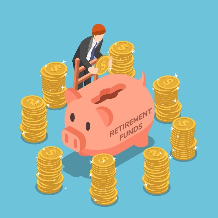 Businessman saving money in piggy bank.
