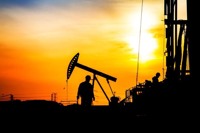 Workers in an oil field.
