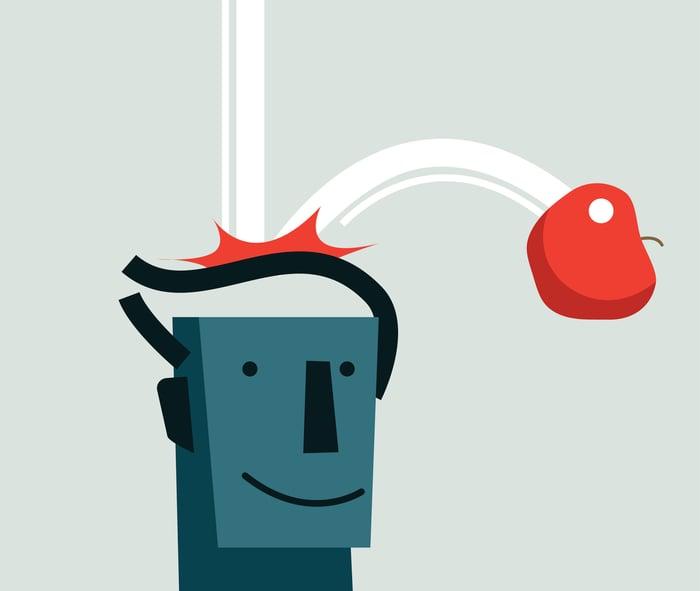 Référence à Sir Isaac Newton -- une pomme tombant et frappant un personnage de dessin animé sur la tête