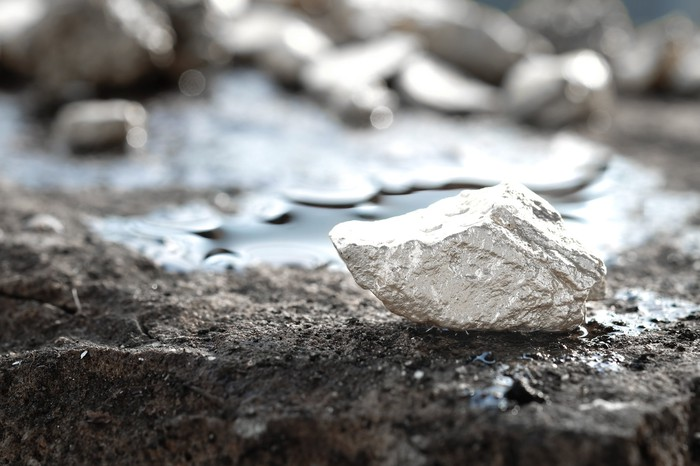 A silver nugget on the floor of a mine.