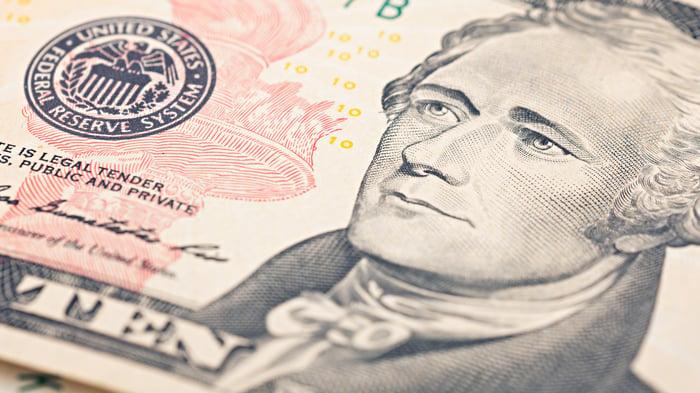 An up-close view of Alexander Hamilton's portrait on a ten dollar bill.