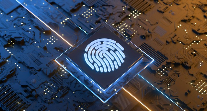 Computer chip emblazoned with a glowing fingerprint.