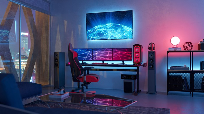A room featuring a high-end gaming computer set-up