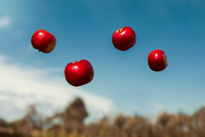 Red apples floating in midair