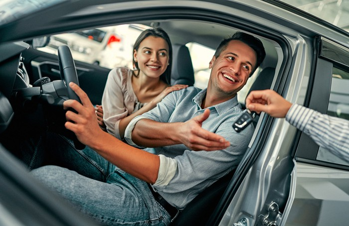 A couple buying a car.