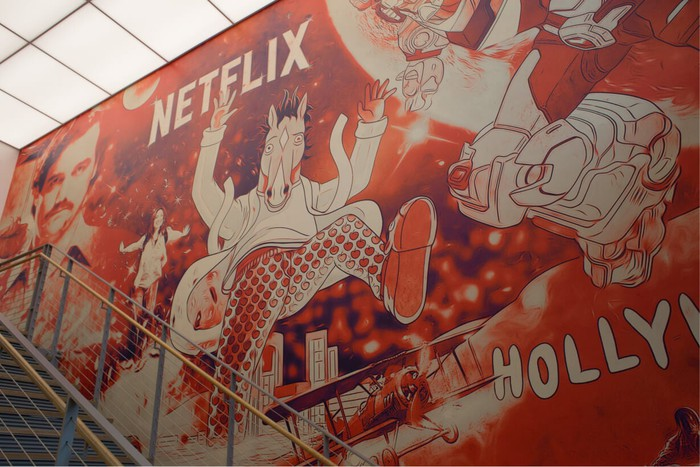 A mural featuring Netflix shows like Narcos and Bojack Horseman.