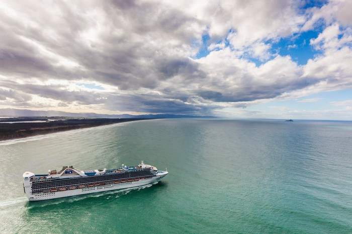 A cruise ship setting sail.