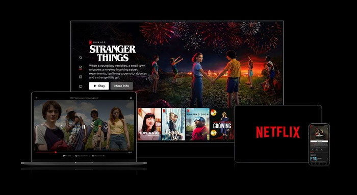 A collage of Netflix content screens on a TV, a laptop, a tablet, and a smartphone.