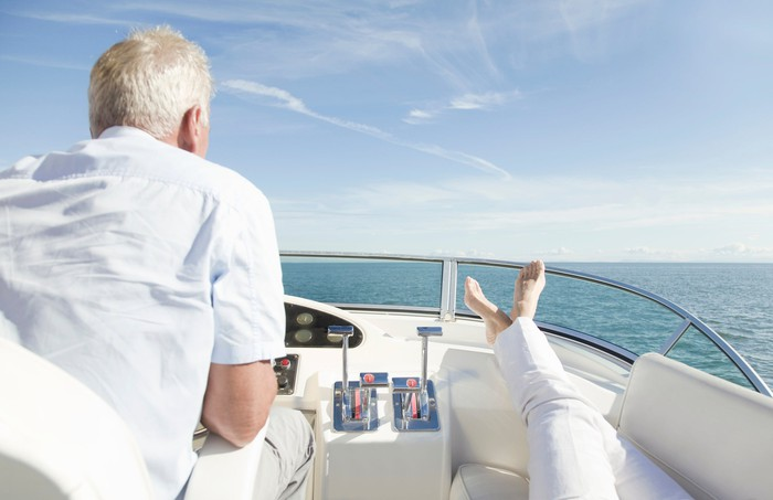 A retired couple heading out to see on their yacht.