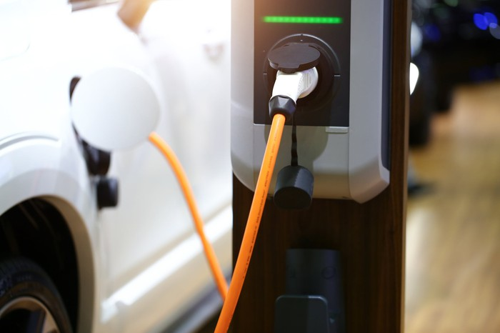 An electric vehicle plugged into a charging station.