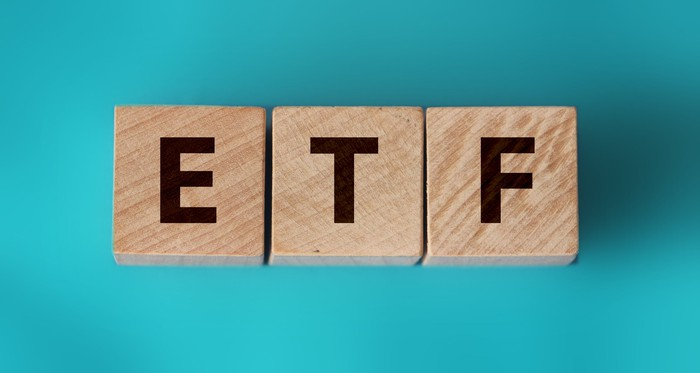 """Wooden blocks spelling out """"ETF,"""" short for exchange-traded fund."""