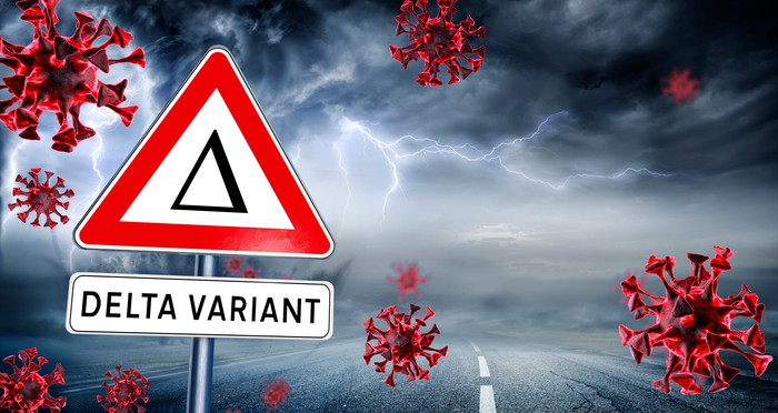 Delta variant sign with images of coronavirus virions and dark clouds with lightning in the background.