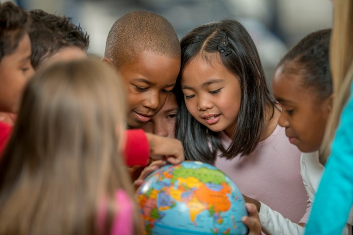 Children looking at a globe.