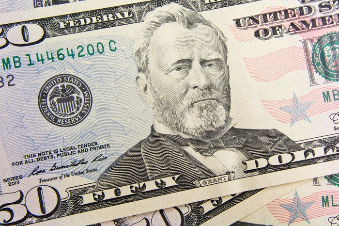 An up-close view of President Ulysses S. Grant's portrait on a fifty dollar bill.