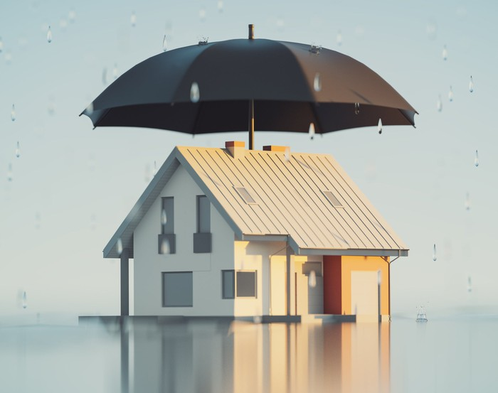 A home covered by a large umbrella.