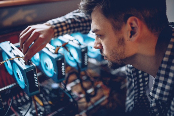 Person working on crypto mining rig.