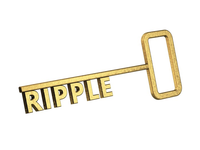 Gold key with the word RIPPLE as the teeth