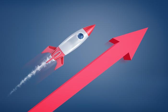 A rocket flying over an arrow.