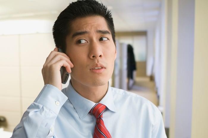 Man talking on cellphone looks worried