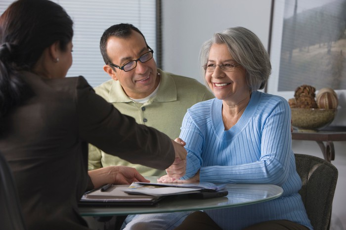 Two people meeting with a financial advisor.