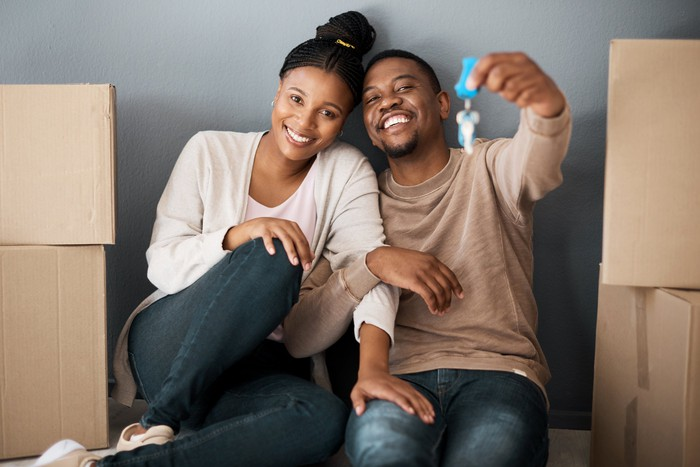 A couple celebrates buying a new home.