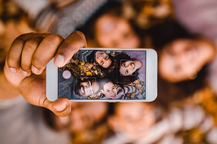A group of people taking a selfie together.