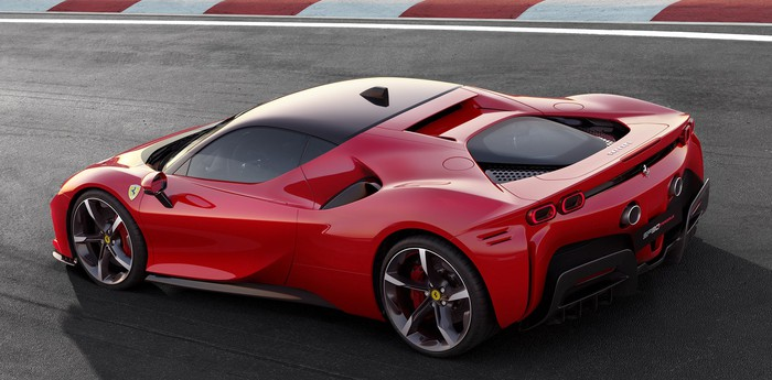A red Ferrari SF90 Stradale, a hybrid mid-engined exotic sports car.